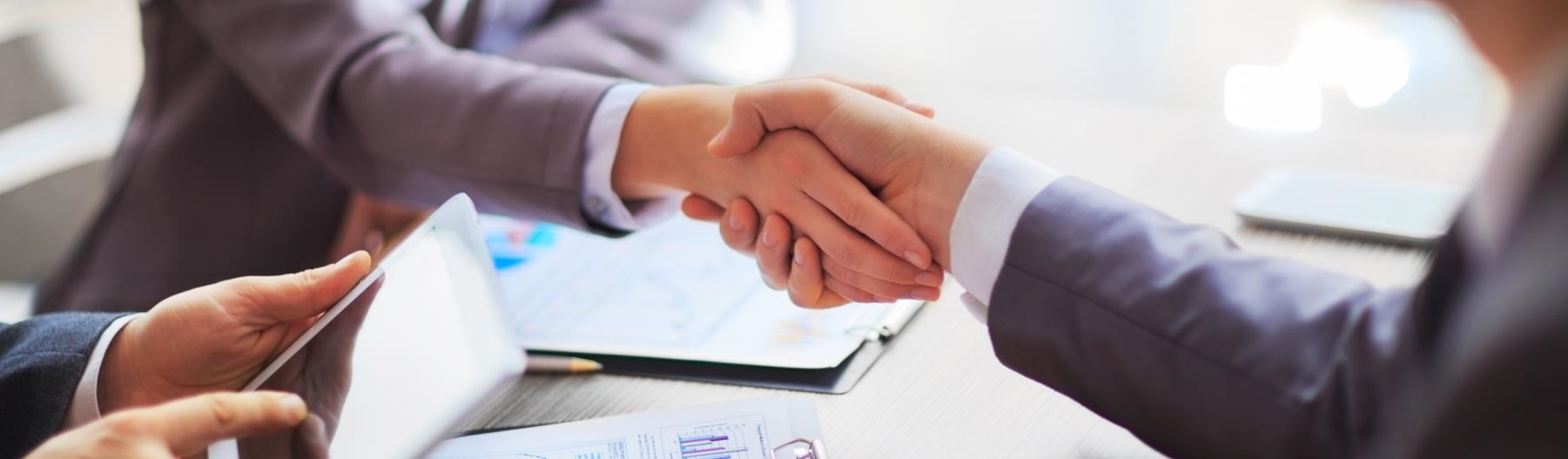 Image of two business people shaking hands.